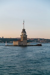 Maiden Tower, Kiz Kulesi on the Asian side of Istanbul at sunset in the middle of Bosphorus, Turkey. One of the symbols of Istanbul. Ancient lighthouse of the Ottoman period. Girl tower. Vertical photo