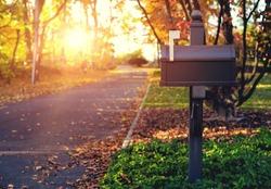 Mail Box in the autumn village. Sunset.