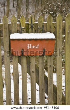 Mail box on a garden gate in winter time
