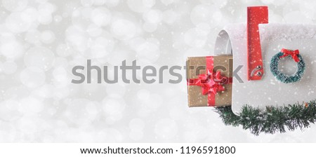 Mail Box on a silver bokeh background with snow effect. Room for your copy. #1196591800