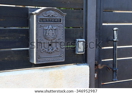 Mail box on the fence at home #346952987