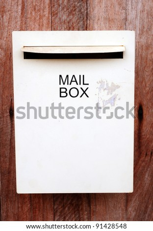 Mail box on wood background.