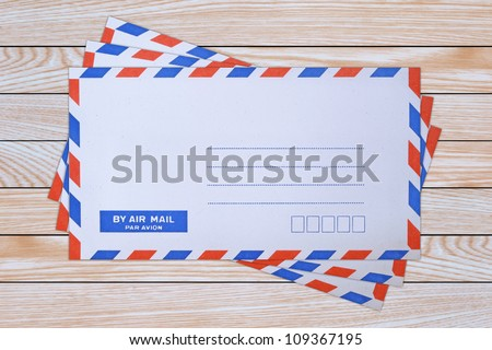 mail envelope on wooden background