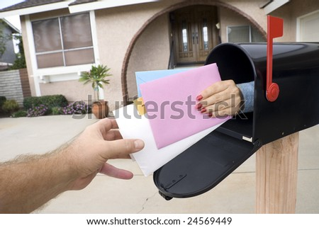 Mail is custom delivered to a home owner who awaits the mail man.