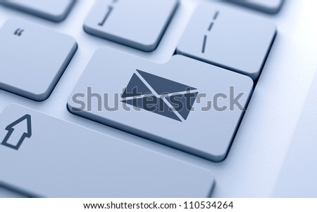 Mail sign button on keyboard with soft focus