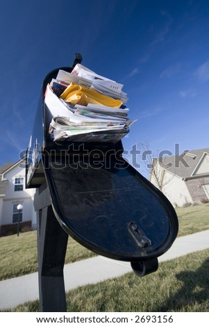Mailbox full of junk mail - stock photo