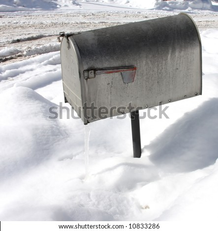 Mailbox in snow with icesicle