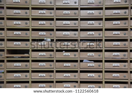 Mailboxes in the condo. wooden mailbox pattern with lockable center in condo.