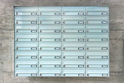 Mailboxes on concrete wall. set of 32 letterboxes
