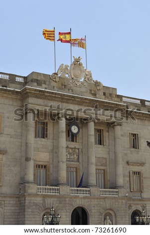 main building of Catalonia Government in Barcelona on Placa Sant Jaume with Catalan,Spanish and Barcelona flags on the top