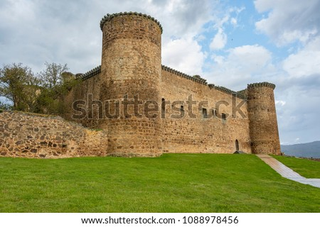 Main facade of the castle of the town of El Barco or Valdecorneja castle built in the twelfth century and rebuilt in the fifteenth century. Community of Castilla la Mancha. Spain Stock photo ©