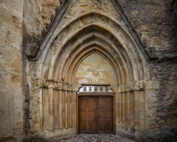 Main front door of Cistercian monastery, located in southern Transylvania, near Sibiu, Romania.