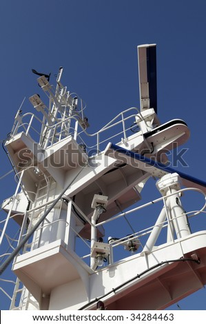Main mast of cargo ship with navigation equipment