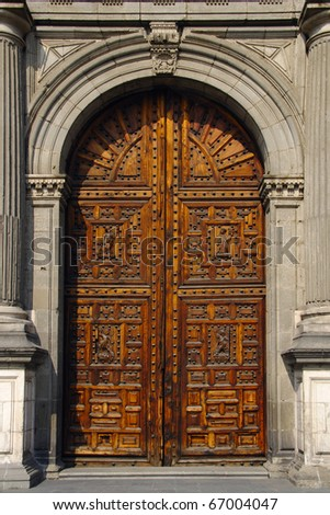 Main portal of Cathedral of the Assumption of Mary of Mexico City - stock photo