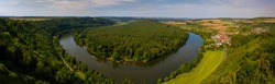 Main river loop in Germany, aerial view. Summer landscape with Main river bend, green fields, Panorama banner