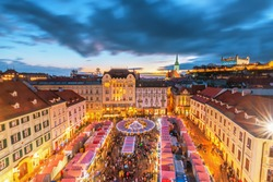 Main square and Christmas market in historical center of Bratislava city at sunset, Slovakia.