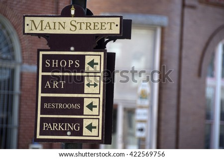 Main Street sign post, Berlin, Maryland, with brick building in soft focus in the background. #422569756