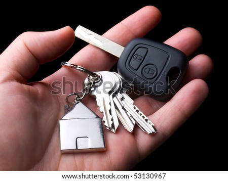 Main symbols of urban standards of living, home and car. - stock photo