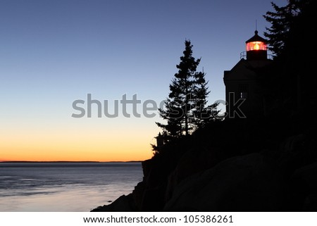 Maine lighthouse at sunset