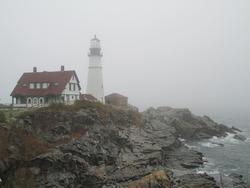 Maine lighthouse on a foggy morning