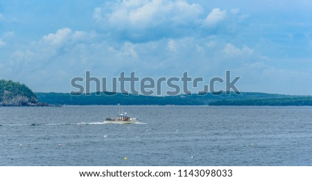 Maine Lobster Boat Running at Sea with Mountains in the Background