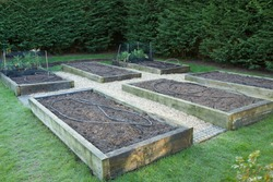 Maintaining a vegetable garden in winter, empty raised beds in a backyard garden, UK