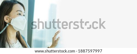 Maintaining mental health.COVID-19 Coronavirus.unemployed asian woman with mask sad and stress from financial and mental health in office.Lockdown, Quarantine at home.Stay at home.Work from home. Foto stock ©