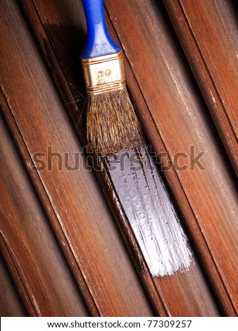 Maintaining  of wooden surfaces with fresh protective paint...
