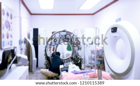 Maintenance engineer repairing and checking CT scanner machine every 3 month in the hospital. Services concept. #1210115389