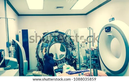 Maintenance engineer repairing and checking CT scanner machine in the hospital. Services concept. #1088035859