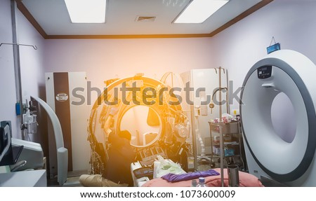 Maintenance engineer repairing and checking CT scanner machine in the hospital. Technology Concept. #1073600009