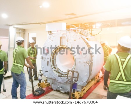 Maintenance Engineers Installation and checking MRI scanner in the hospital. #1467670304
