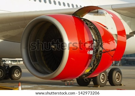 Maintenance of the jet engine before take off.