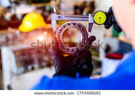 Maintenance technicians are using Vernier od od ball bearings. Сток-фото ©