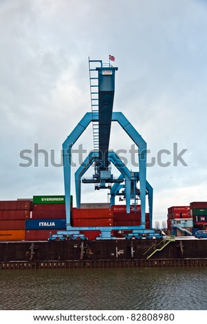 MAINZ, GERMANY - JANUARY 1: crane and container in harbor in Winter on January, 1, 2010 in Mainz, Germany. It was constructed by Eduard Kreyssig between 1880 and 1887 and placed on an old roman war harbor.