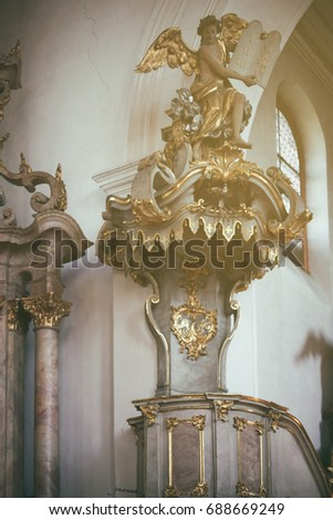 MAINZ, GERMANY - MAY 14: A gold-decorated angel decorates a side of the altar of St. Stephans Church on May 14, 2017 in Mainz / Gold angel #688669249