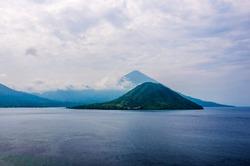 Maitara Island, a beuatiful view of small island, sea and mountain in Ternate, North Maluku, Indonesia.