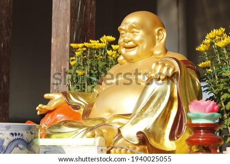 Maitreya Buddha.Asian Maitreya Buddha. Maitreya Buddha Statue. Maitreya Buddha is sitting