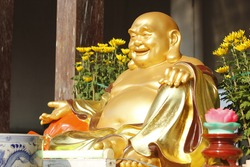Maitreya. One of the most worshiped Buddhas in Buddhist temples.