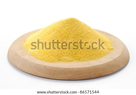 Maize flour on a cutting board - stock photo