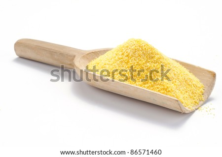 Maize of flour on a wooden scoop
