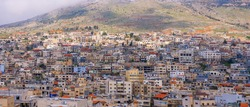 Majdal Shams Druze village houses on the slopes of Hermon mountain, Northern Israel, Panoramic image.