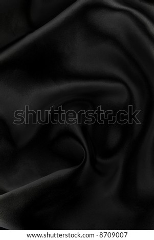 Majestic black silk textile background. Beautiful playing of light & shadow