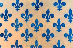 Majestic blue Fleur-de-lis pattern painted on a wall in Palazzo Vecchio - a museum in Florence, Italy