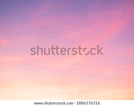 Majestic dusk. Sunset sky twilight in the evening with colorful sunlight. Pastel colors. Abstract nature background. Moody pink, purple clouds sunset sky with long shutter