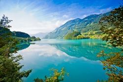 Majestic emerald mountain lake in Switzerland
