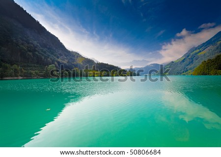 Majestic emerald mountain lake in Switzerland