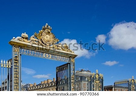 majestic entrance to the castle of Versailles (France)
