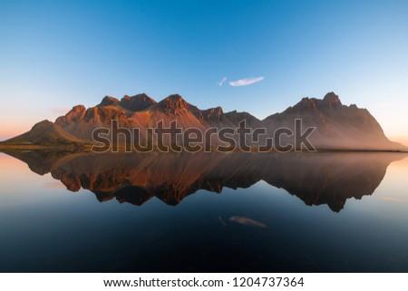 Majestic Icelandic Bat Mountain vestrahorn sunrise water reflection #1204737364