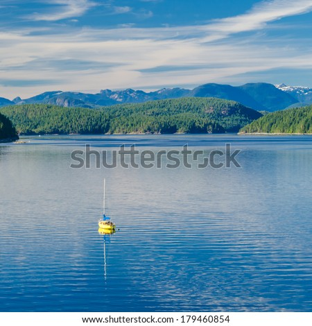 Majestic mountain lake with boat in Canada.